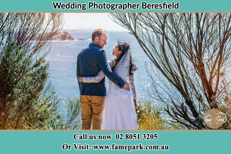 The Groom and the Bride staring at each other in front of the shore Beresfield