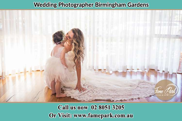 Photo of the Bride kissing her loving flower girl Birmingham Gardens