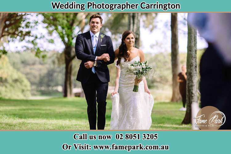 Photo of the Groom and the Bride walking the aisle Carrington NSW 2294