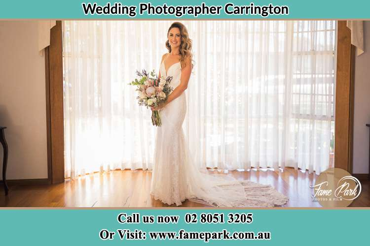 Photo of the Bride holding flower bouquet Carrington NSW 2294