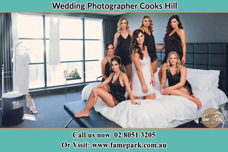 Photo of the Brides together with her bridesmaids posing at the bed wearing lingerie Cooks Hill NSW 2300