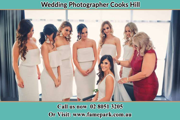 The Bride is being prepared for her wedding as the girls looked on Photo of Groom checking his watch Cooks Hill