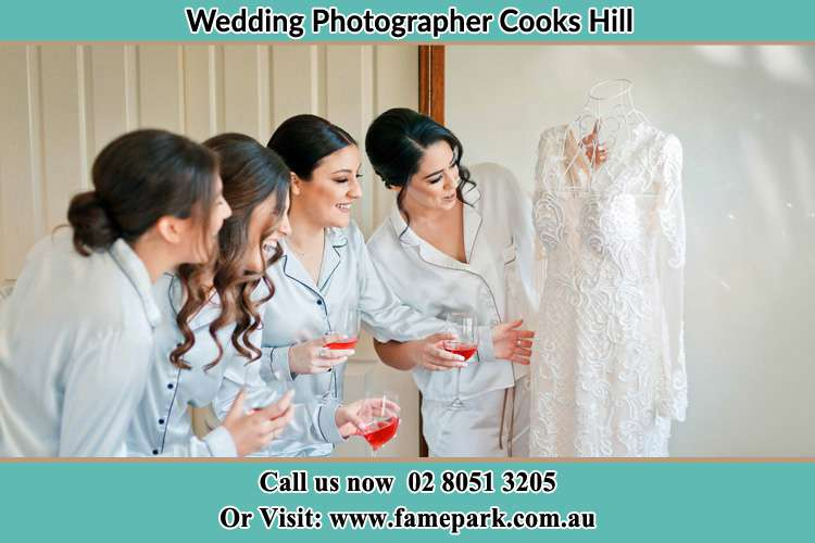Photo of the Bride showing her wedding gown to her bridesmaids Cooks Hill NSW 2300