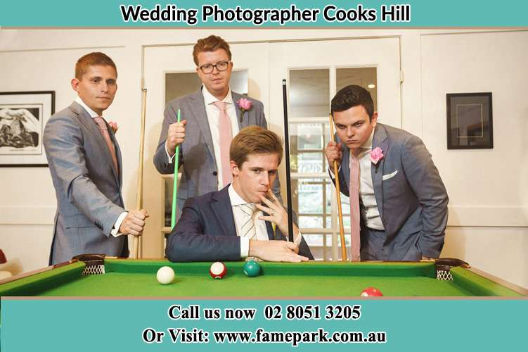 Photo of the Groom with his groom men strike a post on the billiard table Cooks Hill NSW 2300