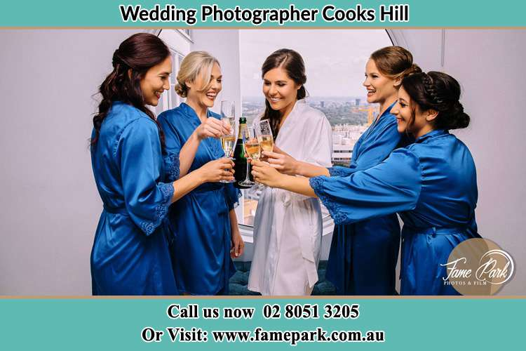 Photo of the Bride tossing wine to her bridesmaids Cooks Hill NSW 2300