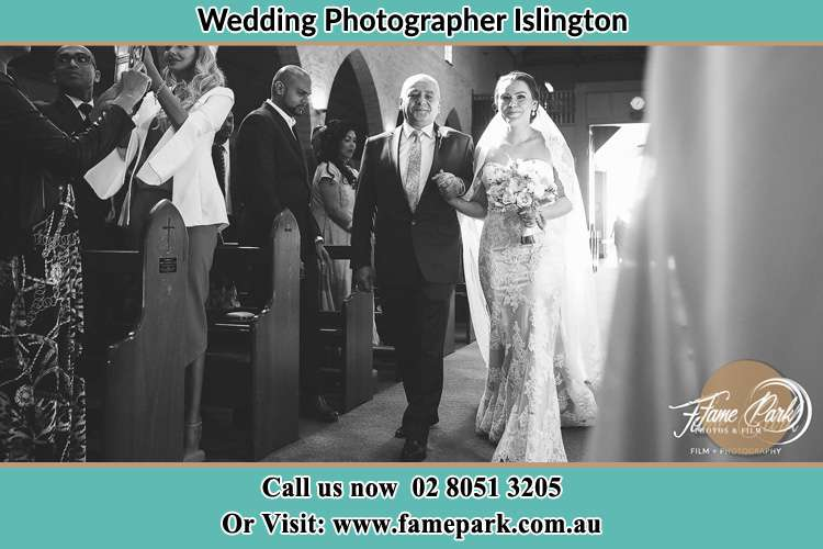 Photo of the Bride accompany by her father walking the aisle Islington NSW 2296