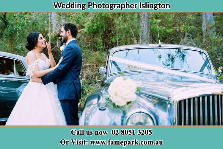 Photo of the Bride and the Groom waiting outside the car Islington NSW 2296