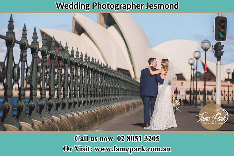 Photo of the Groom and the Bride walking together on the street Jesmond NSW 2299