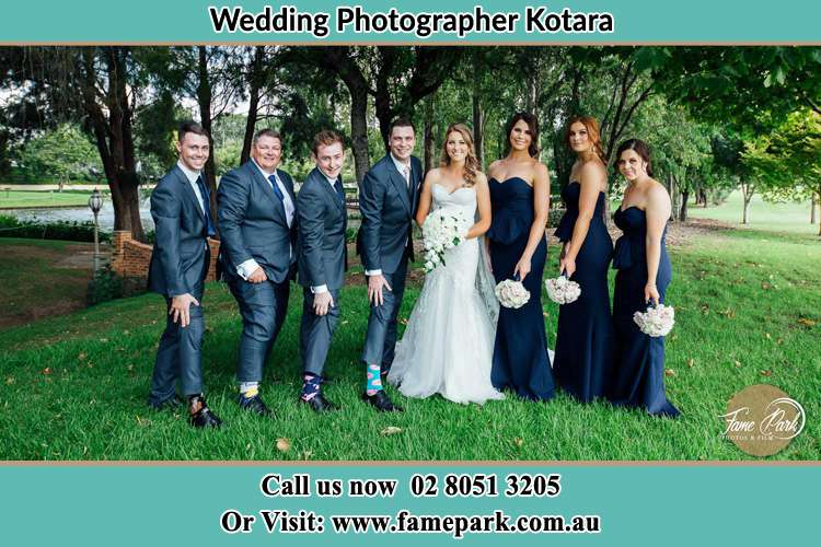 The Bride and the Groom with their entourage pose for the camera Kotara