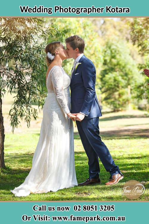 Photo of the Bride and the Groom kissing Kotara NSW 2289