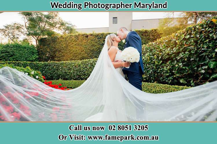 Photo of the newly weds kissing in the garden Maryland