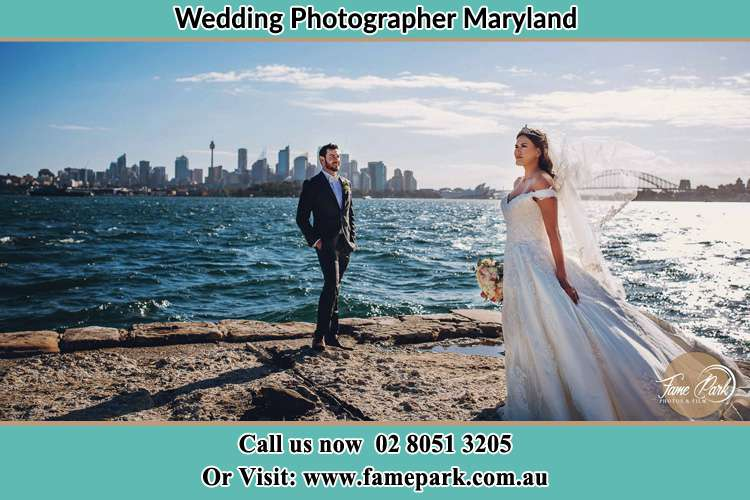 Romantic photo of the Groom and the Bride at the sea front Maryland NSW 2287