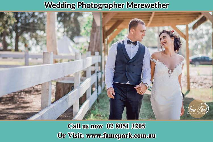 Photo of the Groom and the Bride holding hand while walking Merewether NSW 2291