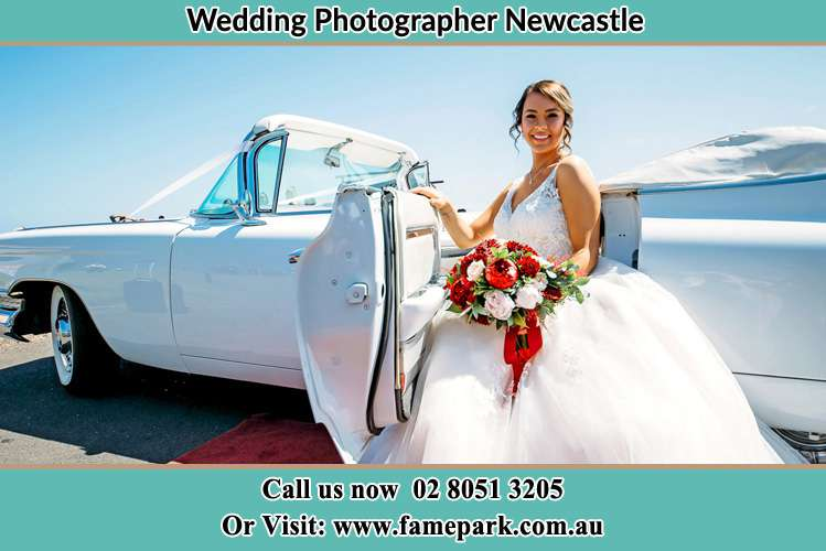 The Bride besides her bridal car Newcastle
