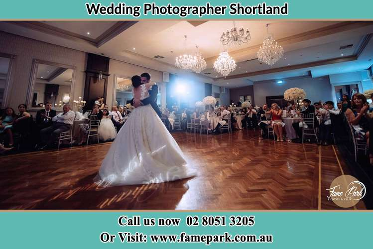 Photo of the Groom and the Bride hugging Shortland NSW 2307