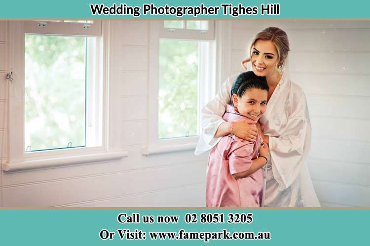 Photo of the exciting Bride hugging her lovely flower girl Tighes Hill NSW 2297