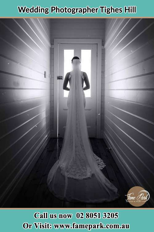 Photo of the Bride going out the door Tighes Hill NSW 2297