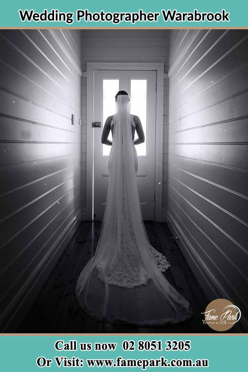 Photo of the Bride waiting for her wedding behind a closed door Warabrook