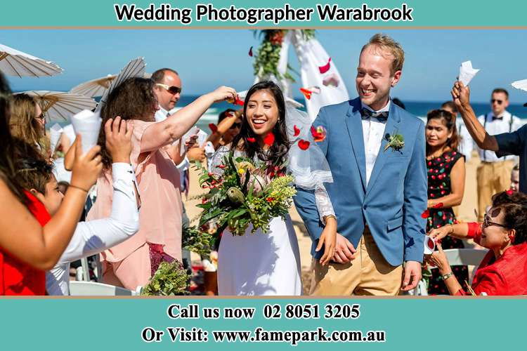 Photo of the Bride and the Groom showering flower petals by their visitors Warabrook NSW 2304