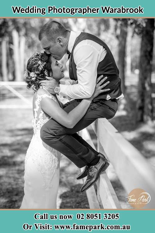Photo of the Groom kissing his Bride Warabrook NSW 2304