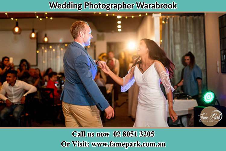 Photo of the Groom and the Bride dancing Warabrook NSW 2304