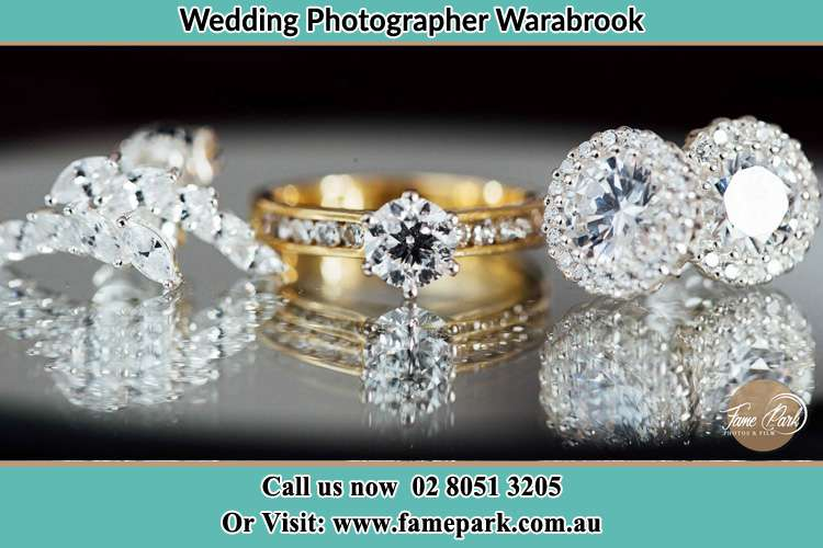 Photo of the engagement ring, cliff and earring of the Bride Warabrook NSW 2304