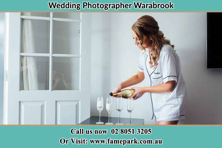 Photo of the Bride pouring wine to the glass Warabrook NSW 2304