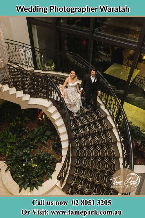 Photo of the Bride and Groom going down the stairs Waratah