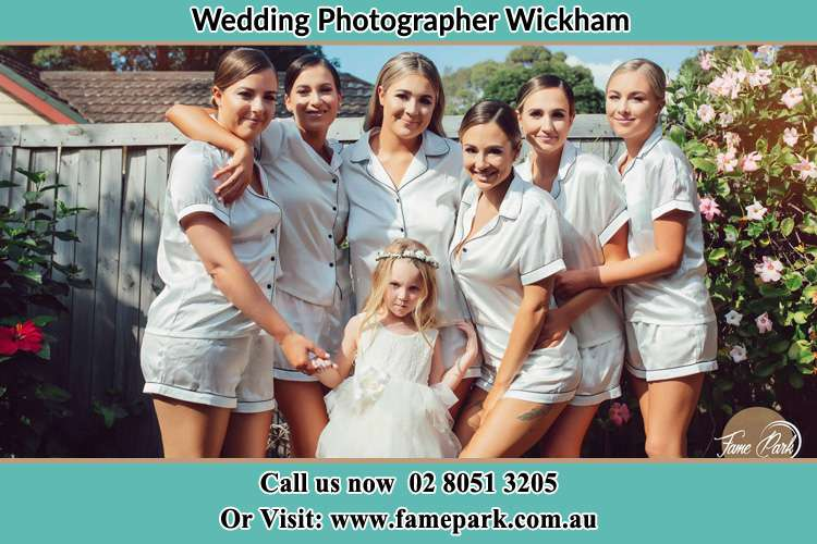 Photo of the Bride together with her bridesmaids and flower girl striking a pose Wickham NSW 2293