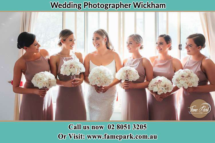 Photo of the Bride and her bridesmaid holding flower bouquet Wickham NSW 2293